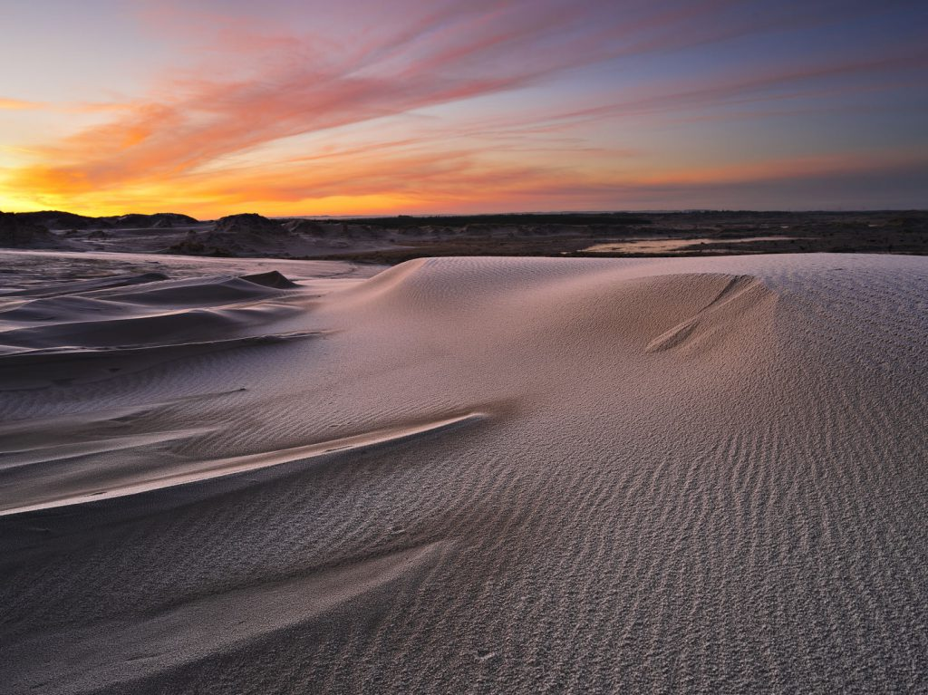 Raabjerg Mile sunset by Niels Thye